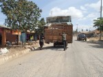 Moving a load. Man in front pulling the cart, Tanzania