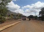 This truck was towing this pole along when he decided to turn right as I began to take the photo, Kenya.