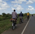 Last bike has a goat tied to the back, Kenya