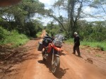 The road, the bikes and National park. Usually bikes are not allowed in National parks. Uganda