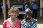 Masai lady on the border with Kenya....note the notice in the background