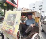Clive in a Becak. I had to sit facing backwards.