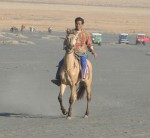 Horseman with horse for carrying visitors up the volcano and across the sands.
