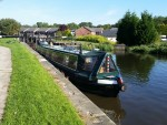 Thin and long barge, this canal takes fatter and shorter too.