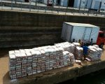 Rice from Paraquay left on quay. I estimate they moved 50 tons manually.