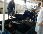 My bike coming out of its hold on the Cisne Branco