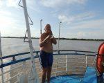 Clive showering on back of boat