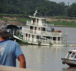 This boat is pushing a barge full of lorries on the Rio Solimoes