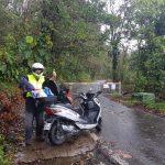 Clive  near volcano Soufriere in the rain. Guadeloupe