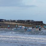 Paddleboarders in the beach series at Takapuna tackle the waves